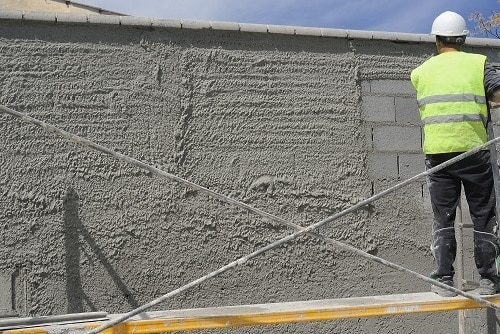 Worker Applying Concrete On The Wall