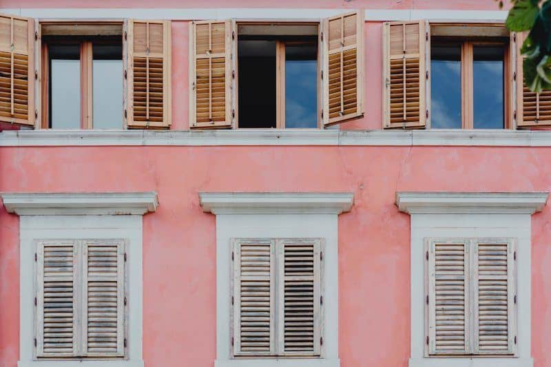 Pink Building with White Shutters