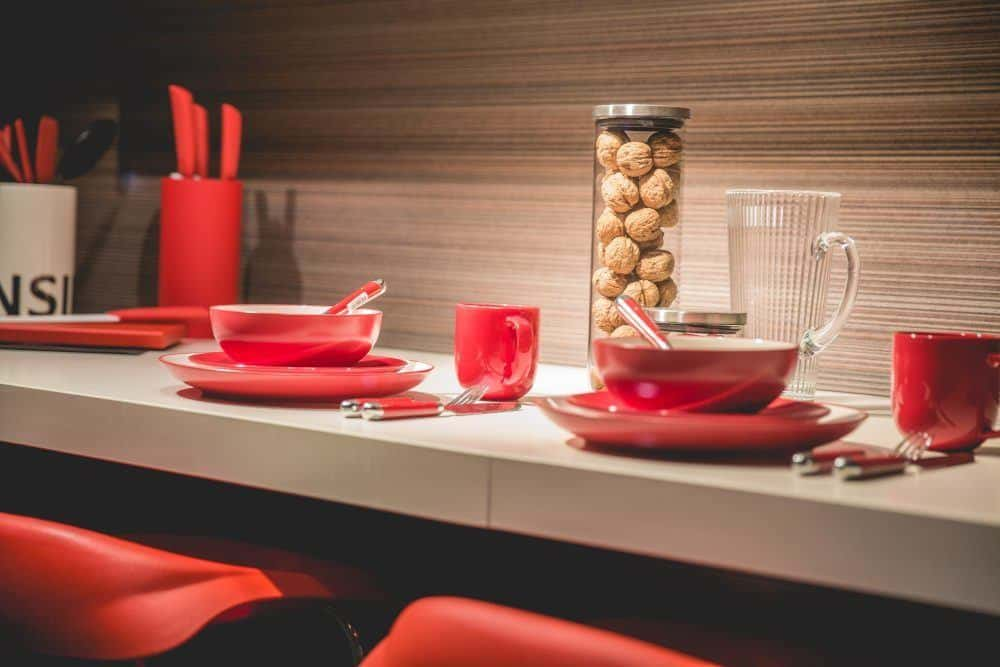 Red Kitchenware on Countertop
