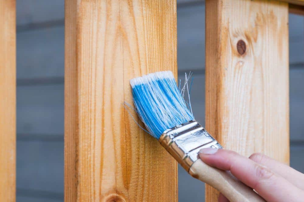 Treating a wooden fence